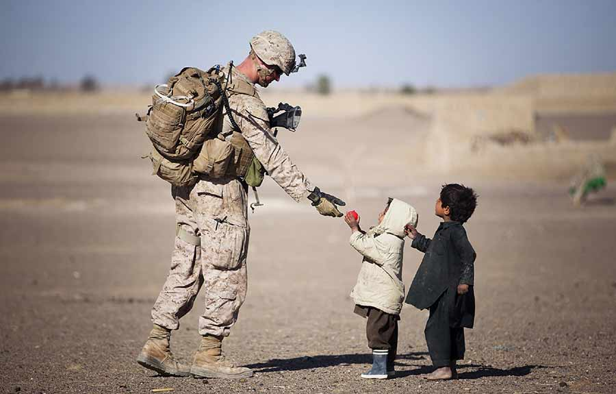 soldier helping kids