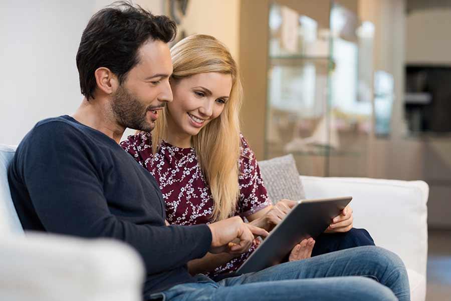 couple doing taxes on laptop